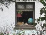 Cat in Cottage Window Dreams of Traveling the Globe, Sligo, Ireland